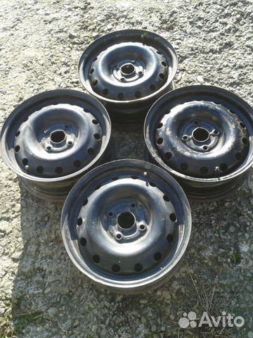 Фото: стальные диски с колпаками 15 4х114,3 на lacetti